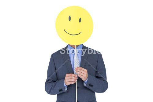 Businessman with happy smiley faced balloon