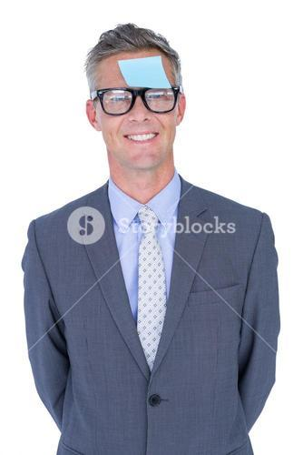 Businessman with post it on his face