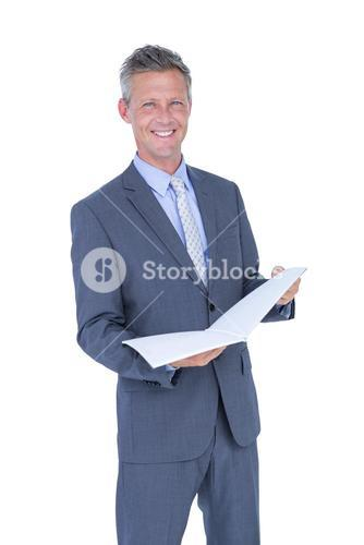 Happy businessman holding files