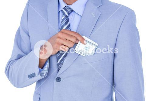 businessman holding bribe