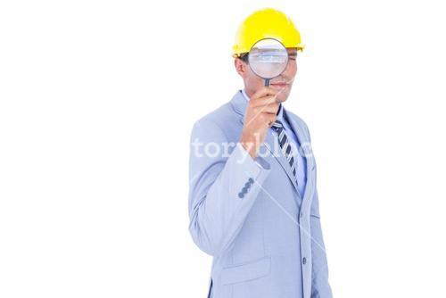 businessman with helmet and magnifier