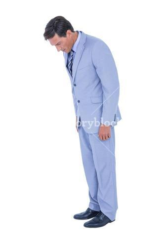Standing businessman looking at his shoes