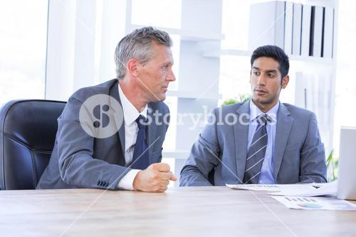 Businessman meeting withcolleague using laptop