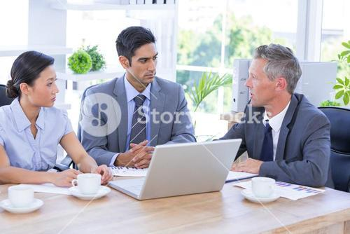 Businessman meeting with colleagues using laptop