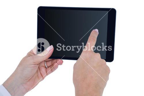 doctor standing with tablet pc