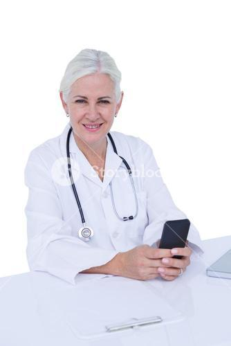 Thinking woman doctor phoning with her smartphone