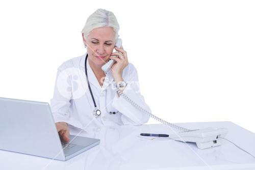 Doctor working on her laptop and on the phone