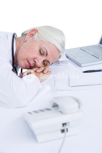 doctor sleeping on her desk