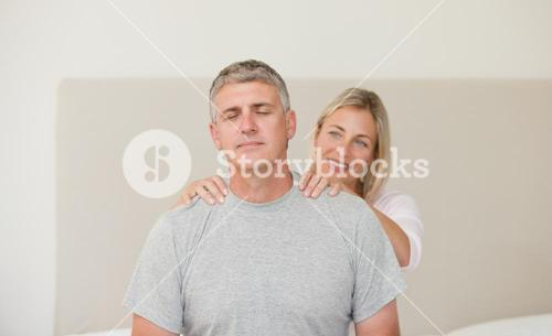 Woman giving a massage to her husband