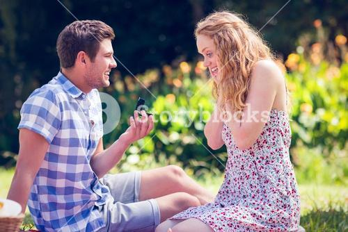 Handsome man doing marriage proposal to his girlfriend