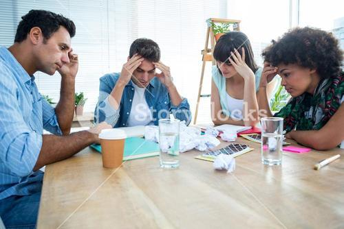 Exhausted creative business team riled up