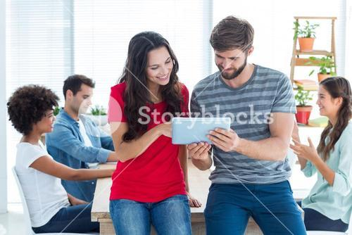 young business people using a tablet