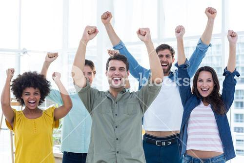 Young creative business people gesturing arm up