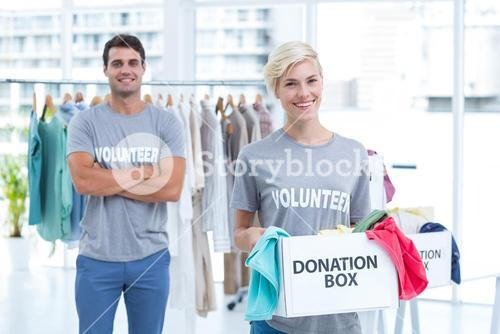 Blonde volunteer holding a donation box