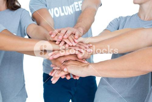 Volunteers friends putting their hands together