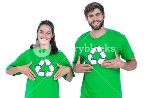 Friends wearing recycling tshirts pointing themselves