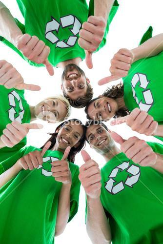 Friends wearing recycling tshirts forming huddle