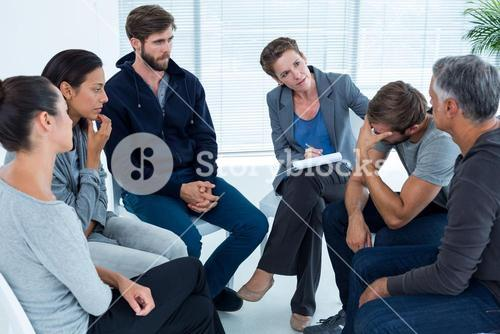 Concerned woman comforting another in rehab group