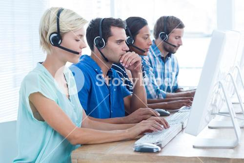 Call centre workers on their laptops
