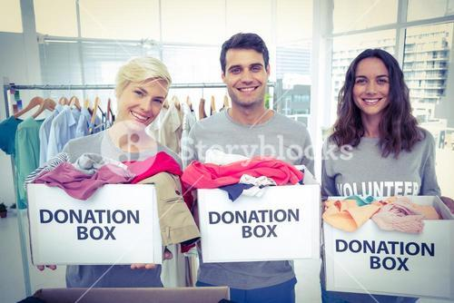 Volunteers friends holding donation boxes
