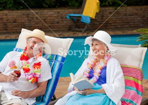 Mature woman reading a book outdoors