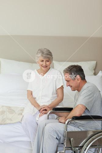 Mature couple in their bedroom