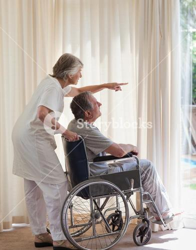Retired couple looking out the window