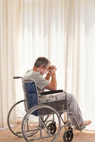 Thoughtful man in his wheelchair