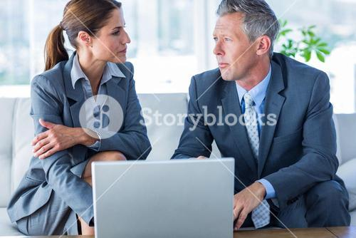 Business people using laptop computer