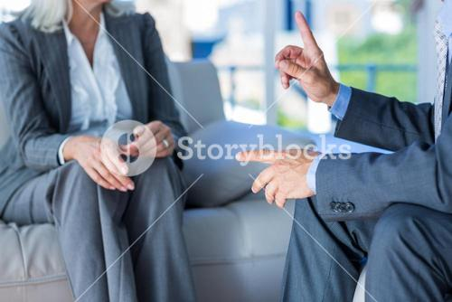 Business people speaking together on couch