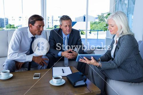 Business people looking at tablet computer