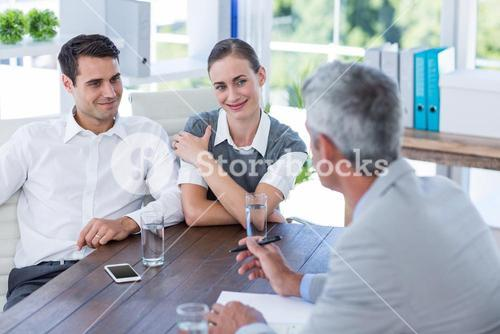 Casual business people speaking together