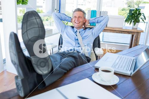 Businessman relaxing in a swivel chair