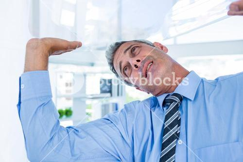 A serious businessman lifting something