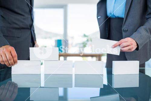 Business people stacking paper bloc