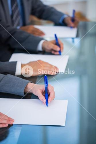 Close up view of businessman hands writing on paper