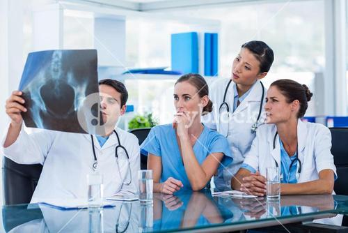 Team of doctors looking at xray