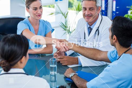 Doctors shaking hands during a meeting