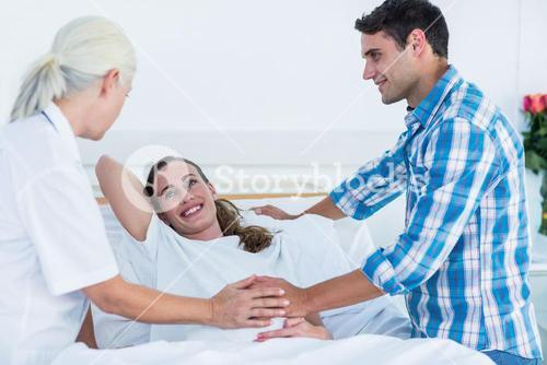 Pregnant woman and her husband having a doctor visit