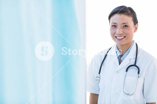 Confident female doctor smiling at camera