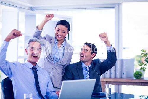 Happy business people cheering together