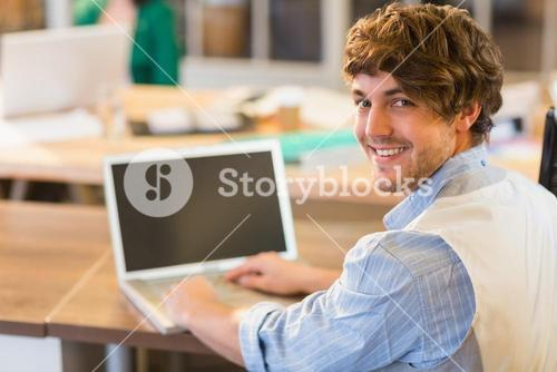 businessman writting on his laptop