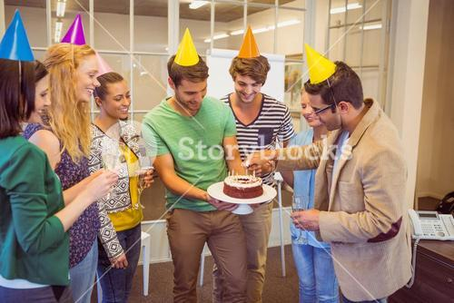 Business people celebrating a birthday