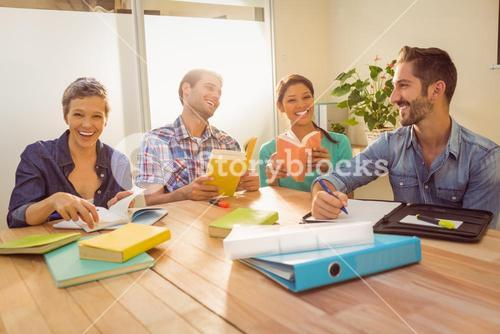 Group of colleagues reading books