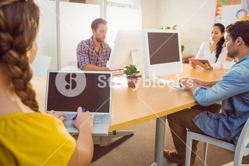 Creative business team working on electronic device