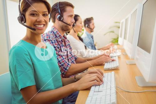 Smiling businesswoman working in a call centre