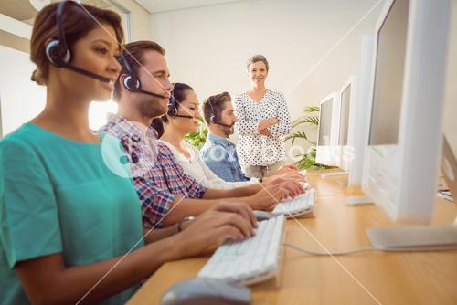 Manager supervising work in call center