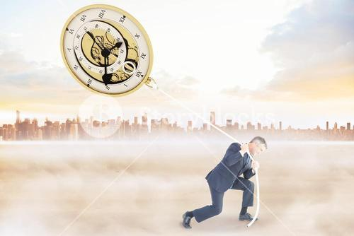 Composite image of classy businessman pulling a rope
