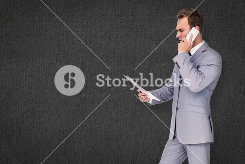 Composite image of businessman on the phone