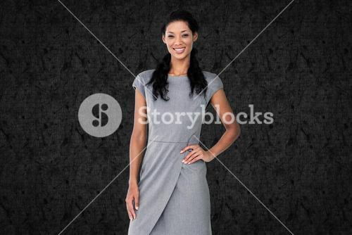 Composite image of businesswoman smiling